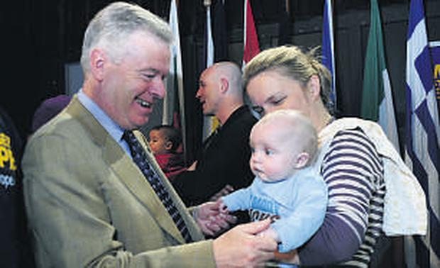 Ireland's former EU Commissioner David Byrne meets a young supporter, Seamus Whelan, at yesterday's event in Dublin's Templebar