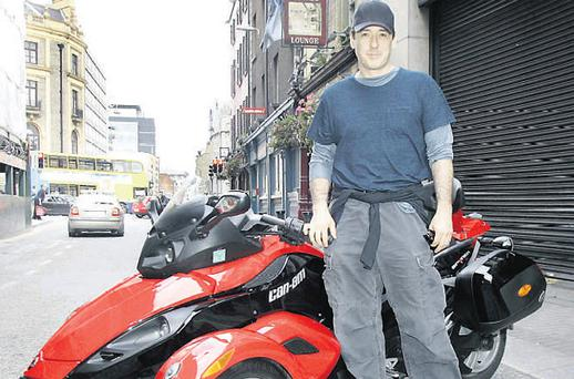 photo of John Cusack BRP Can-Am Spyder roadster - car
