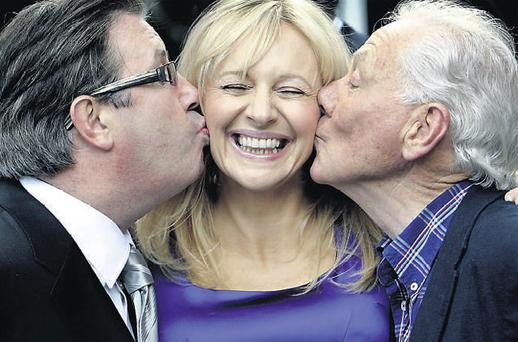 Gerry Ryan and Gay Byrne give Miriam O'Callaghan a peck on the cheek yesterday as RTE unveiled its autumn radio schedule. Photo: STEVE HUMPHREYS