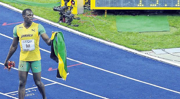 Usain Bolt celebrates his 200m world record in Berlin last night
