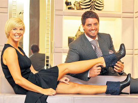 Keith and Lisa Duffy at Brown Thomas, Dublin, yesterday to announce the arrival of the exclusive Donegal Tweed Jimmy Choo boots.