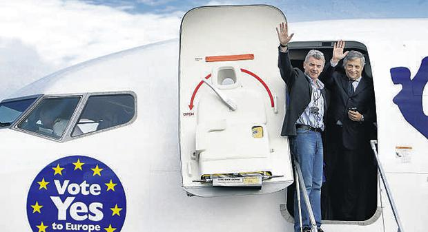 Ryanair chief Michael O'Leary arriving for a pro-Lisbon press conference at Knock Airport yesterday with EC vice-president Antonio Tajani