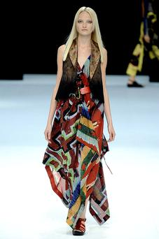 A model wears a colourful maxi dress with waistcoat from the Issey Miyake Spring/Summer 2010 collection. Photo: Getty Images