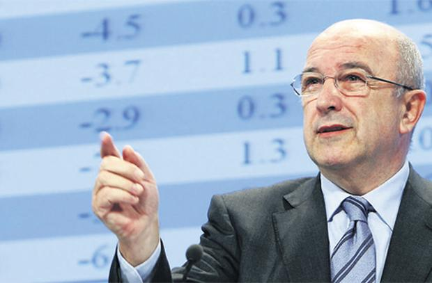 Looking up: EU Monetary Affairs Commissioner Joaquin Almunia delivers the Autumn 2009 Economic Forecasts for the 27 member states in Brussels, Belgium yesterday.