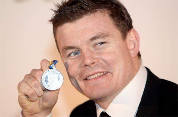 A beaming Brian O'Driscoll displays the UCD medal