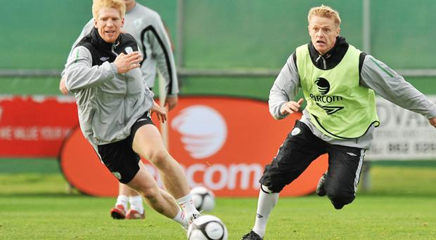 Paul McShane and Damien Duff in action during Ireland's training session in Malahide yesterday