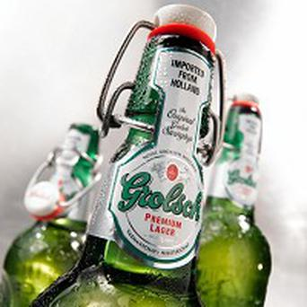 Grolsch owner SABMiller's interim pre-tax profits dipped 26%