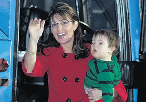 Sarah Palin, with her son Trig, has been criss-crossing the United States