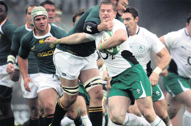 South Africa's Danie Roussouw gets to grips with Jamie Heaslip