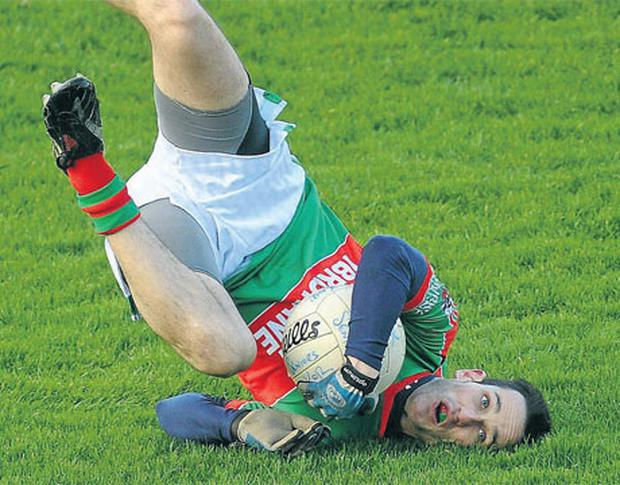 Michael O'Dwyer of Kilmurry Ibrickane falls awkwardly during the first half of his team's Munster Club SFC final against Kerins O'Rahilly's