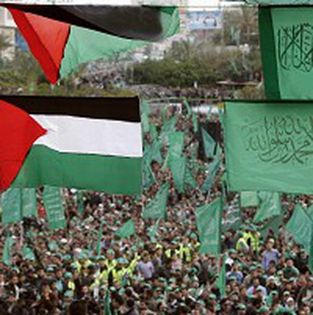 Palestinian Hamas supporters attend a rally to mark the 22nd anniversary of the group's founding in Gaza City