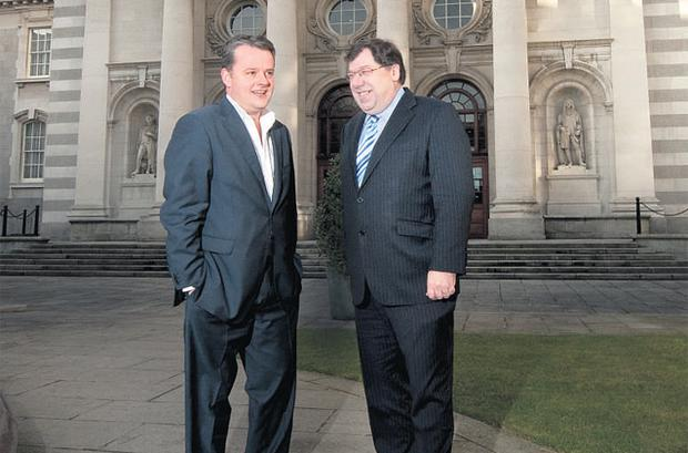 STAYING UPBEAT: Jody Corcoran and Taoiseach Brian Cowen outside Government Buildings last week, when Mr Cowen opened up on his leadership style - and discussed the tough choices he has deemed necessary to keep the banks afloat, while bolstering both public and business confidence