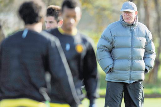 Alex Ferguson watches over his players in training ahead of tomorrow's game