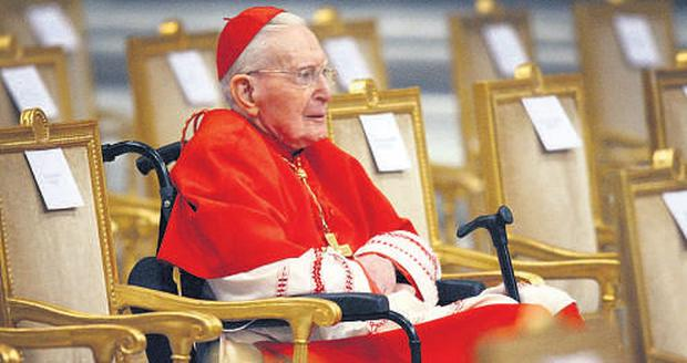 RED HAT: Cardinal Daly at the consistory of cardinals in St Peter's Basilica, Rome.