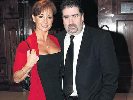 LAST ORDERS: Dublin's King of Clubs Robbie Fox - pictured here with his wife Martina - was chased through the courts for €2.2m owed on personal guarantees.