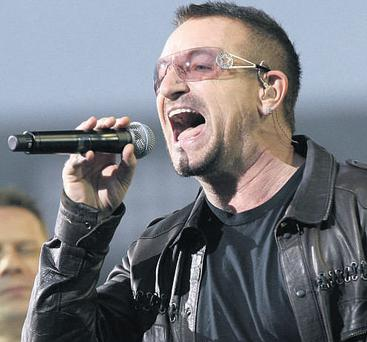 U2 frontman Bono, writing in the New York Times, has called for tougher action against illegal file-sharing websites to protect artists.