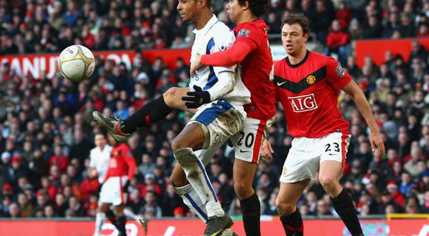 Jermaine Beckford of Leeds United tangles with Fabio Da Silva of Manchester United during the FA Cup at Old Trafford Photo: Getty Images