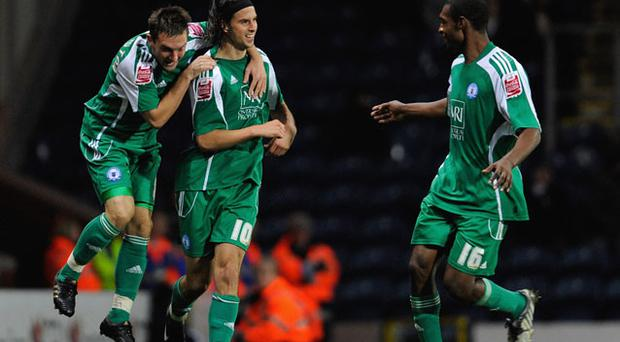 George Boyd (centre) about to be headhunted. Photo: Getty Images