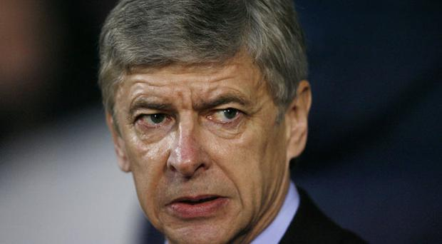 Arsene Wengers team most likely to give Owen Coyle a baptism in fire. Photo: Getty Images