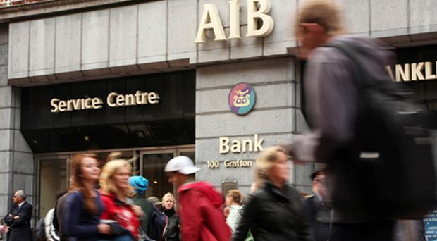 AIB rose on the announcement by Brian Lenihan. Photo: Bloomberg News