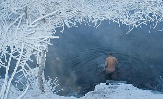 A man takes a dip in a river in northeast China