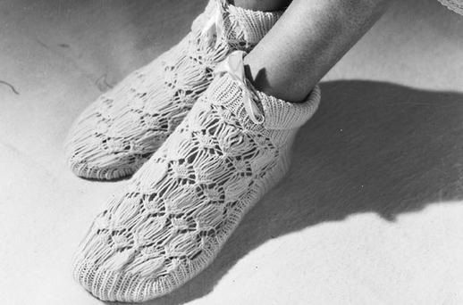 Old fashioned bed socks to keep us warm? Photo: Getty Images