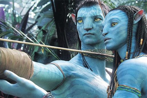 Actors Sam Worthington (left) and Zoe Saldana as their digital characters Jake and Neytiri are shown in a scene from the James Cameron 3-D film Avatar now drawing large audiences for Cineworld