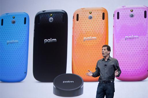 Jon Rubinstein, chief executive officer of Palm, speaks about the Palm Pixi Plus and Touchstone dock during the Consumer Electronics Show (CES) in Las Vegas. Photo: Bloomberg News