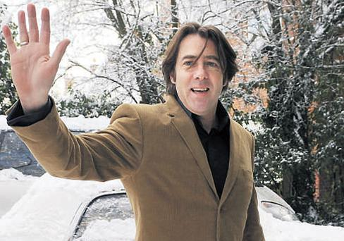 Jonathan Ross waves to the media outside his home in north London yesterday after he announced that he is quitting the BBC