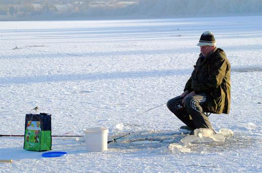 A Lithuanian man ice fishing on Ballinafid lake outside Mullingar, Co Westmeath yesterday
