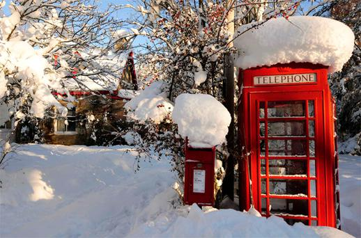 A telephone booth covered in snow near Aviemore in the Scottish Highlands