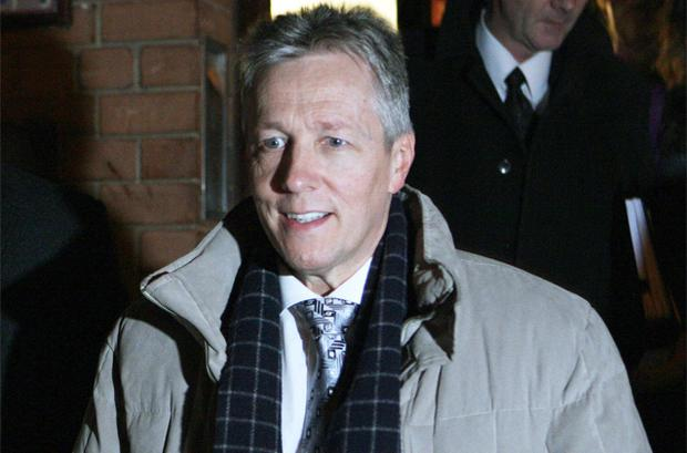 First Minister Peter Robinson leaves the DUP headquarters in Belfast after a press conference yesterday