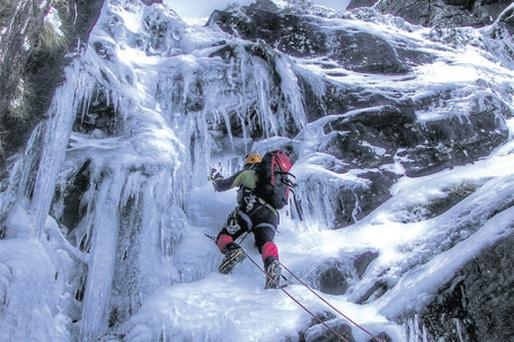 Rock climber John Hussey, from Killarney, equipped with shoe crampons,an ice axe and ropes, navigates his way up Carrauntoohil Mountain in Kerry at the weekend