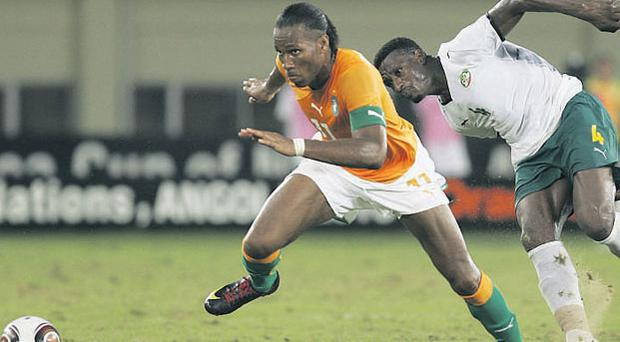 Didier Drogba gives Mamadou Tall of Burkina Faso the slip during the Africa Cup of Nations match in Cabinda yesterday