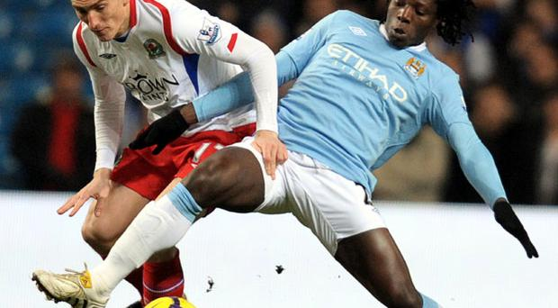 Benjani Mwaruwari (R) vies with Keith Andrews during match at The City of Manchester stadium Photo: Getty Images