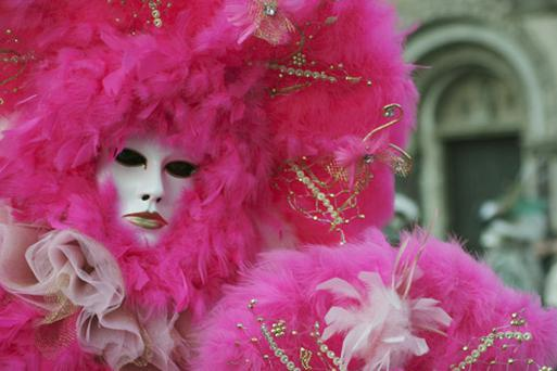 A masked reveller at the Venice Carnival, Getty Images