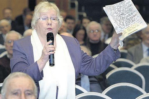 Former employee and shareholder Breda O'Byrne asking a question at the sparsely attended Bank of Ireland egm