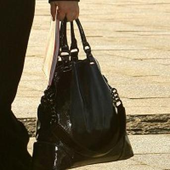 The average weight of a woman's handbag has fallen by half, research claims