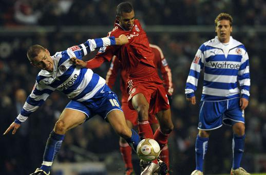Liverpool's David N'Gog (C) challenges Reading's Icelandic defender Ivar Ingimarsson. Photo: Getty Images