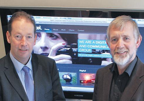 Agtel managing director John Cummins, and director of corporate services Michael Parker