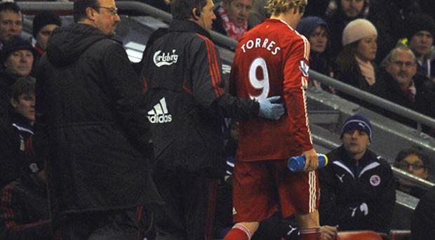 Fernando Torres leaves the field after being injured against Reading during last night's game. Photo: Getty Images