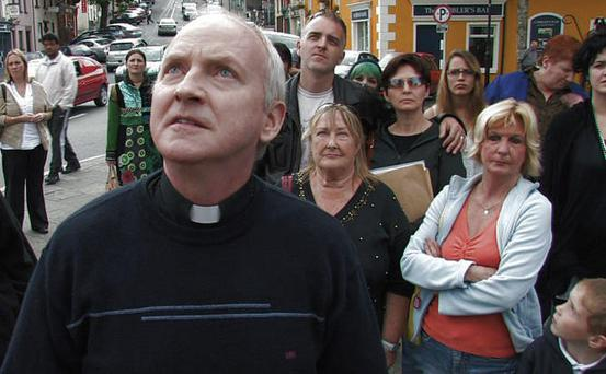 Watch us online: Fr Leonard (Christopher Dunne) and locals from Westport hope to attract the big guns with their DIY drama, Covies