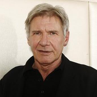 Harrison Ford has opened up about his experiences of parenthood