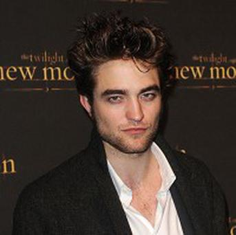 Robert Pattinson is rumoured to be taking over from Tobey Maguire