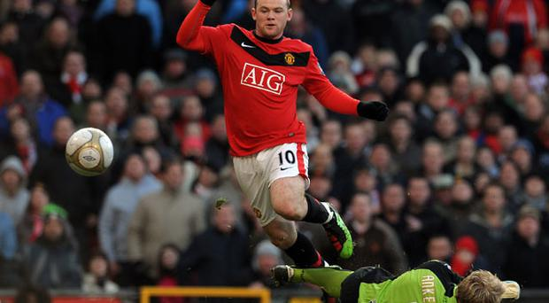 Star turn: Manchester United forward Wayne Rooney has been tipped to take the World Cup by storm. Photo: Getty Images