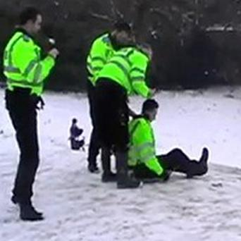 Policemen filmed using a riot shield as a sledge have been reprimanded
