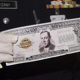 A fake banknote for a non-existent 100,000 US dollars seized by police in Malaysia