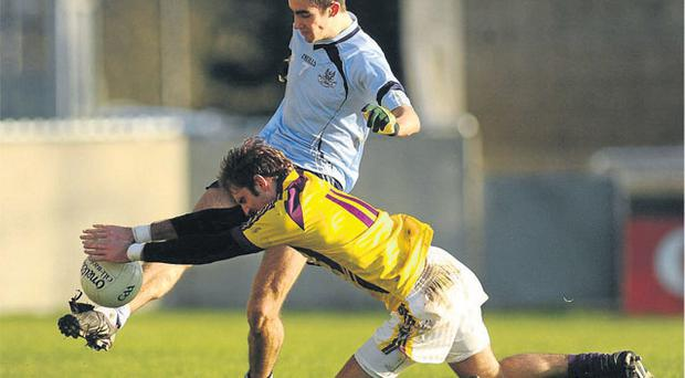 Wexford's Brian Malone blocks the pass of Dublin's James McCarthy during Dublin their O'Byrne Cup clash in Parnell Park yesterday STEPHEN MCCARTHY / SPORTSFILE