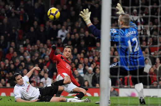 Dimitar Berbatov scores the key first goal for Manchester United Photo: Getty Images