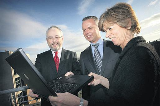 Checking out the website of the Pensions Board's interactive e-learning system for pension scheme trustees were, from left, Brendan Kennedy, chief executive Pensions Board; Jerry Moriarty, director of policy IAPF; and Mary Hutch, head of regulation, Pensions Board